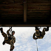 Pararescuemen Take Part In A Rappelling Poster
