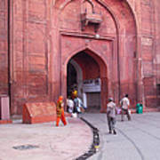 People Entering The Entrance Gate To The Red Colored Red Fort In New Delhi In India Poster