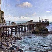 Pier Along Rocky Shore Poster