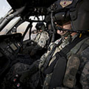 Pilot In The Cockpit Of A Uh-60l Poster