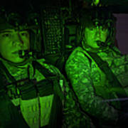 Pilots In The Cockpit Of An Oh-58d Poster
