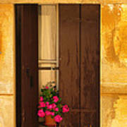 Pink Geraniums Brown Shutters And Yellow Window In Italy Poster