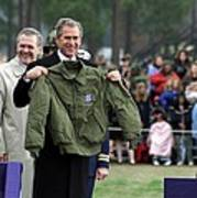 President Bush Displays A Jacket Given Poster