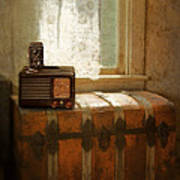 Radio And Camera On Old Trunk Poster