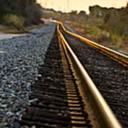 Railroad Tracks At Sundown Poster