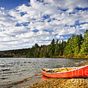 Red Canoe On Lake Shore Poster