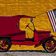 Red Truck Against Yellow Wall Poster