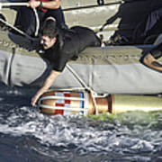 Rescue Swimmers Pull A 480-pound Poster