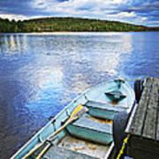 Rowboat Docked On Lake Poster