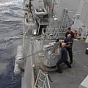 Sailors Fire A Mark 38 Machine Gun Poster