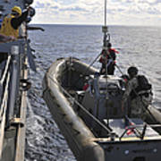 Sailors Lift A Rigid-hull Inflatable Poster
