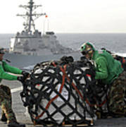 Sailors Move Supplies On The Flight Poster