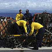 Sailors Prepare Pallets Of Cargo Aboard Poster