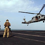 Sailors Prepare To Board An Mh-60s Sea Poster