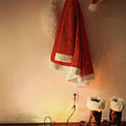 Santa Costume Hanging On Coat Hook With Christmas Lights Poster