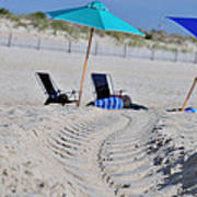 seashore 82 Beach Chairs Beach Umbrella and Tire Treads in Sand Poster
