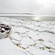 Small Boat Sits On Ice Chuncks In Wellfleet On Cape Cod In Winte Poster