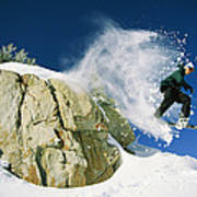 Snowboarder Jumping Off A Big Rock Poster