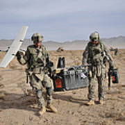 Soldiers Carry An Rq-11 Raven Unmanned Poster