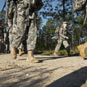 Soldiers Conduct A Ruck March At Fort Poster