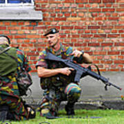 Soldiers Of The Belgian Army Helping Poster