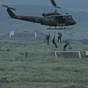 Soldiers Rappel From A Helicopter Poster