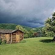 Storm Clouds Form Above A Log Cabin Poster