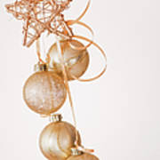 Studio Shot Of Gold Christmas Ornaments Poster by Daniel Grill