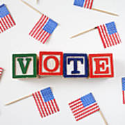 Studio Shot Of Small American Flags And Wooden Blocks With Text Vote Poster