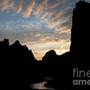 Sunset With Rugged Cliffs In Silhouette Poster