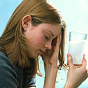Teenager With Headache Holds Dissolving Painkiller Poster