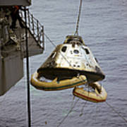 The Apollo 9 Command Module Is Hoisted Poster
