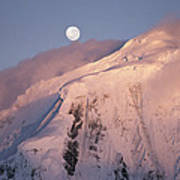 The Moon Rises Over Snow-blown Peaks Poster