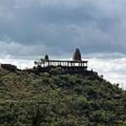 The Structure Of An Abandoned Temple On The Top Of A Green Covered Hill With Blue And White Clouds I Poster