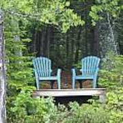 Two Chairs Sit At A Lakeside Camp Poster