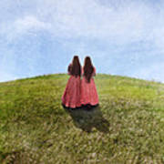 Two Girls In Vintage Dresses Walking Up Grassy Hill Poster
