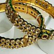 Two Green And Gold Bangles On Top Of Each Other Poster
