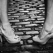 Two Young Women Wearing High Heeled Shoes And Fake Tan On Cobblestones On A Night Out Poster by Joe Fox