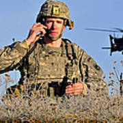 U.s. Army Captain Directs An Ah-64 Poster