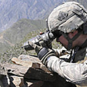 U.s. Army Soldier Monitors An Afghan Poster
