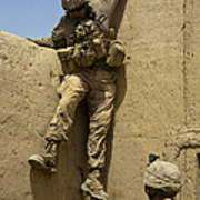 U.s. Marine Climbs Down From An Poster