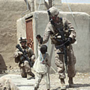 U.s. Marine Gives An Afghan Child Poster