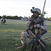 U.s. Marine Utilizes A Satellite Radio Poster
