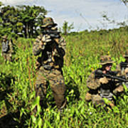 U.s. Marines Guard An Extraction Point Poster