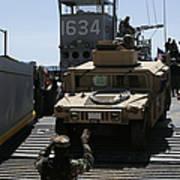 U.s. Marines Load An M1114 Humvee Onto Poster