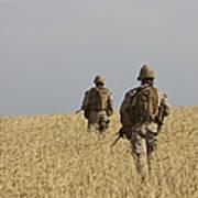 U.s. Marines Patrol A Wadi Near Kunduz Poster