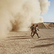 U.s. Marines Walk Away From A Dust Poster