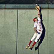 Usa, California, San Bernardino, Baseball Player Making Leaping Catch At Wall Poster