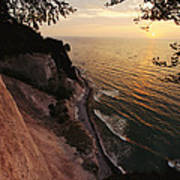 View Looking Down Cliffs At Sunset Poster
