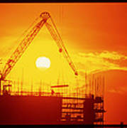 View Of A Construction Site At Sunset Poster